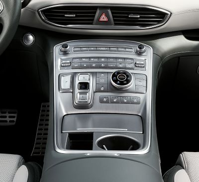An interior view of the centre console of the new Hyundai SANTA FE Hybrid 7 seat SUV.