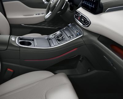 An interior view of the new Hyundai SANTA FE Hybrid SUV showing the tray under the centre console.
